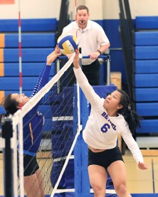 Slamtastic! Jessica Mute of Bethel (at right) tips the ball over the net during their match with Kotzebue at the Slamtastic Volleyball tournament held last weekend. Teams from Nome, Wasatch Academy, Chevak, and Hooper Bay played in the event.