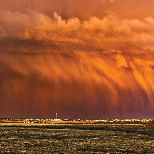 Spring Skies over Bethel A rainbow and the tundra are overshadowed by a spectacular looking downpouring cloud on May 3rd, 2016 in Bethel with the setting sun giving it a fiery glow.