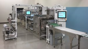 Delta ModTech Converter with packager, reject and shingling conveyors, and vision verification