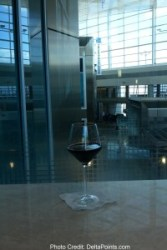 a glass of red wine centurion lounge delta points review