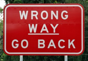 road sign wrong way go back