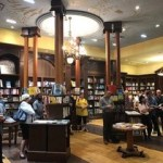 Photo from the book launch of Death of a Butterfly: Mental Health Court Diaries from September 11, 2019 at Ben McNally Books. People stand in the store listening to author Richard D. Schneider speak.