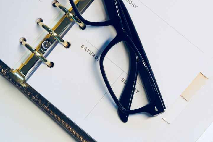 black framed wayfarer style eyeglasses on white surface