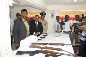 FLASH BACK: Public Security Minister, Khemraj Ramjattan; Prime Minister Moses Nagamootoo and Police Commissioner Seelall Persaud viewing a number of illegal firearms that had been surrendered during a gun amnesty  last year.