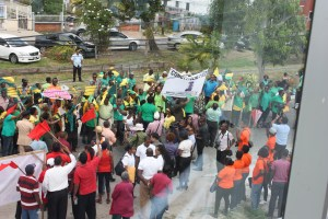 Supporters and candidates of APNU+AFC and PPPC outside GECOM's office on Nomination Day.