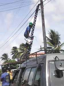 A street light being removed from a utility pole in a Berbice village. (Kaieteur News photo)