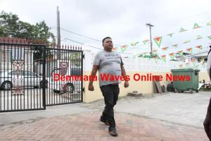 Barry Dataram entering the Public Service Department's compound at Vlissengen Road and D'Urban Street to appear before Inquiry Commissioner Brigadier Brewster Lovell.