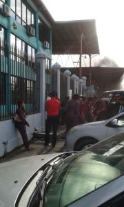 Several employees of Gafoors Complex outside as flames engulfed the building.