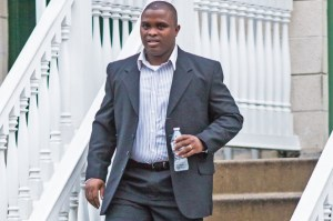 Wayne Isaacs is seen leaving his home on his way to court Tuesday. (NEW YORK POST PHOTO)
