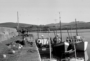 Piers - Cleggan fishing boats at the pier by Bill