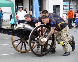 """Burgh turns-out to witness Field Gun Public RunIT WAS a case of sun's out gun's out on May 22 when residents and visitors alike headed to Helensburgh to witness HMS Neptune's Field Gun public run.Hundreds of spectators gathered to cheer along the 18-strong team of Royal Navy sailors from nearby HM Naval Base Clyde. The run was part of the Neptune team's preparations in the run-up to the annual Field Gun Competition at HMS Collingwood in Hampshire on Saturday, June 2.Captain of HMS Neptune, Captain Craig Mearns, said: """"We would like to thank everyone who came along to show their support to HMS Neptune Field Gun crew.""""They aren't just HM Naval Base Clyde's team, but also Helensburgh's. Hopefully the encouragement they've received today will hold them in good stead at the upcoming Field Gun Competition.""""The team, who are sponsored by Lockheed Martin Strategic Systems UK and Babcock, have undergone weeks of training in preparation for the competition. The gunners have endured demanding physical fitness training twice a day, as well as continual training with the one-tonne Field Gun."""