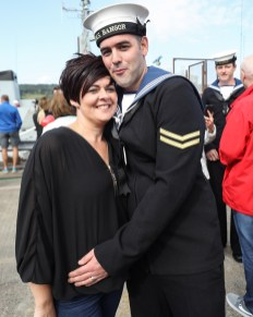 HMS Bangor Returns pictured here Maree and Matthew Stewart HMS Bangor, one of the Royal Navy's seven Sandown-class mine countermeasures ships, has left Bahrain after three years of Middle East heat and returned back to her home in Faslane, Scotland. Families lined the jetty to welcome the Faslane based MCMV home after three years in Bahrain. Over the past three years the ships have surveyed across the Gulf, visited 15 different countries, entertained countless VIPs and once in their home ports, will have travelled more than 40,000 nautical miles each. *** Local Caption *** consent held