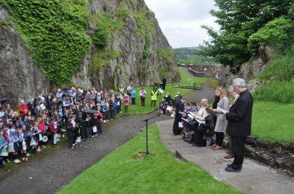 SCHOOLS gather on Dumbarton Rock for the anti sectarianism pageant and picnic with Canon Gerry Conroy (right) leading the service and George Campbell and Gemma Doyle MP.