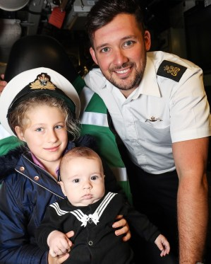 Ambush Families Day Pictured here; Evie Murphy Rex Bleckley and Ryan Bleckley ROYAL NAVY Submariners recently welcomed their loved-ones to their workplace when HMS Ambush held a families' day at HM Naval Base Clyde. The Astute-class vessel – which is the second of three currently in service with the Royal Navy – opened her hatches on Friday, September 21. *** Local Caption *** consent held