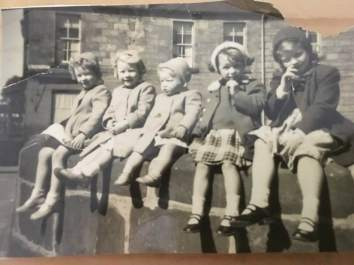 Brucehill memories 3 McLaughlin girls ( left to right) Mary Catherine Marion. 2 Mellor girls lived in Levenhaugh st. Born in Brucehill, Maureen and Marie ( picking nose)