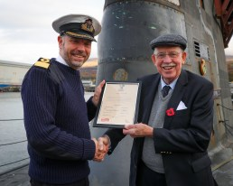 Sir Boyd Tunnock KBE, inventor of the legendary Tunnock's Teacake and owner of confectionary empire Tunnock's Ltd., visited HM Naval Base Clyde on Wednesday, November 6, to sign the Armed Forces Covenant. The head of the family-owned, Uddingston-based, business was invited to the Home of the UK Submarine Service by Rear Admiral John Weale CB OBE, Rear Admiral Submarines. During the visit Sir Boyd was shown around Royal Navy Astute Class attack submarine and also spent time with Royal Marines from 43 Commando Fleet Protection Group. The Armed Forces Covenant is a promise by the nation ensuring that those who serve or who have served in the armed forces, and their families, are treated fairly.