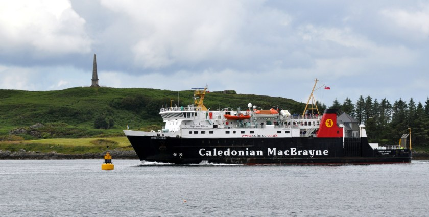 Oban 1 A Calmac ferry, Lord of the Isles, sails into Oban Bay with Kererra and the Hutcheson Memorial in the background..jpg