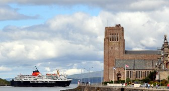 Calmac ferry passing St Columba's Cathedral in Oban