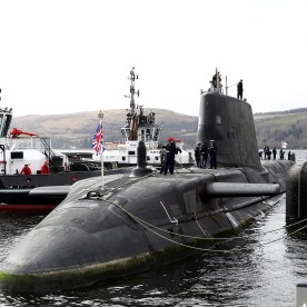 "HMS AUDACIOUS ARRIVES AT CLYDE HOME HMS Audacious, the fourth of the Royal Navy's Astute-class submarines, has arrived at her new home at HM Naval Base Clyde. The new submarine and her 98-strong crew arrived at the Naval Base in Argyll and Bute today (April 7), flying the White Ensign after sailing from BAE Systems in Barrow-in-Furness. Welcoming the vessel to her new home were members of the Submarine Flotilla – SUBFLOT – based at Clyde. ""It is with great excitement that we welcome HMS Audacious to the Clyde, joining her three sister submarines,"" said Commodore Jim Perks OBE, Head of the Submarine Service. ""HMS Audacious represents an ever improving example of the world-leading Astute class submarine. She is right at the cutting-edge of technology, built here in the UK by our own people. She will provide the country with remarkable security at sea to protect our nation's interests."" HMS Audacious will join sister-submarines HMS Astute, HMS Ambush and HMS Artful which are already in-service and operating from Faslane. A further three boats – named Anson, Agamemnon and Agincourt - are currently under construction at BAE in Barrow. The Astute-class vessels are among the most sophisticated submarines ever constructed for the RoyalNavy."