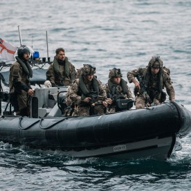 ROYAL MARINES OF 43 COMMANDO TRAIN ON THE FAMOUS ROCK OF GIBRALTAR Pictured: Royal Marines of P Squadron, 43 Commando, insert via landing craft onto a jetty at the base of the Gibraltar Rock before navigating a series of cave complexes in order to reach an objective within the Rock itself. Royal Marines from Scotland-based 43 Commando Fleet Protection Group have taken part in demanding training exercises on, and within, the Rock of Gibraltar, perfecting techniques they use in their top-secret mission as the elite guardians of the United Kingdom's strategic nuclear deterrent. Over 80 of these highly trained Commandos spent 2 weeks in early November on Exercise Serpent Rock honing the skills necessary for their no-fail mission protecting the Nation's nuclear assets. This annual exercise sees the Royal Marines making best use of Gibraltar's unique terrain, undertaking amphibious and cliff assaults, close quarter battle in urban environments and within the network of tunnels the Rock is famous for, as well as patrolling its streets, thoroughfares and the narrow alleyways and passages that pepper this British overseas territory.