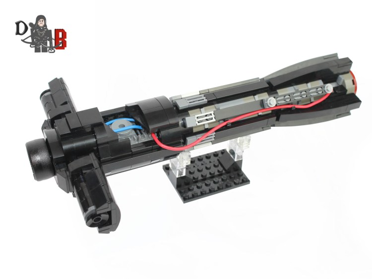"""This listing is for all the parts to build your very own Kylo Ren Lightsaber hilt with stand inspired by the Force Awakens. It comes unassembled and upon purchase I will email you a PDF copy of the instructions and send out all the pieces necessary to build it as pictured. This is a slightly complicated build so if you need further assistance I can send the LDD file also. This is a 1:1 replica of Kylo Ren's Lightsaber hilt and measures 29cm in length and is 9cm tall on the stand. Has over 400+ pieces and is made using genuine LEGO parts except for the red and blue electrical cable which will come pre-glued to a piece in the center. Each Lightsaber is carefully packaged into a re-sealable bag and shipped in a bubble lined envelope for extra protection. """"LEGO® is a trademark of the LEGO Group of companies. The LEGO Group does not sponsor, authorise or endorse the modified/customised product(s) shown nor does it accept responsibility in any way, shape or form for any unforeseen and/pr adverse consequences following from such customisation/modification.""""*Not associated with Lucas film/Star Wars/Disney."""