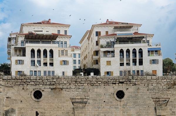 Walking along the seafront in Jaffa you can see new buildings in the old ruins. Jaffa, Tel Aviv