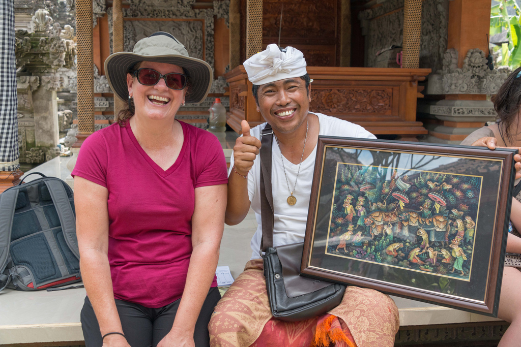 Denise and the Balinese artist posing with our first piece of art that we purchased during our trip.