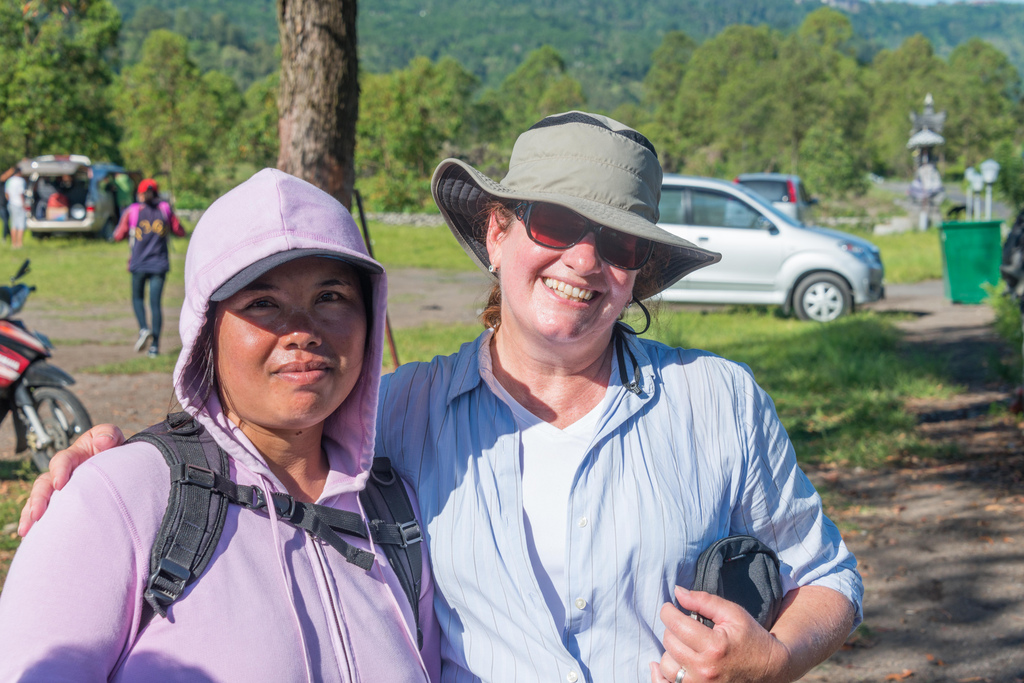 Denise and her guide Nyoman after the long walk up and down the Mount Batur volcano.