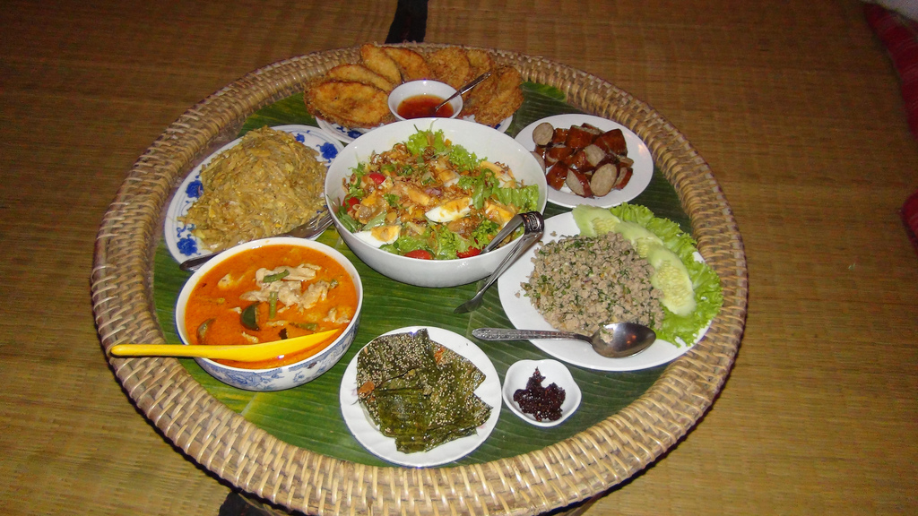 A full spread of traditional Lao food.