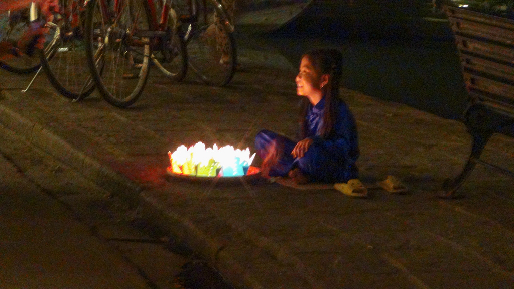You can buy a floating candle from a really cute kid along the river walk.