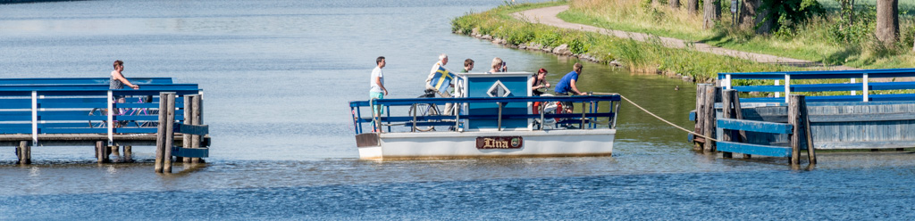 """The World's Smallest Ferry,"" the Lina. It will take you across the canal for 1 Krone. The crossing takes 20 seconds."