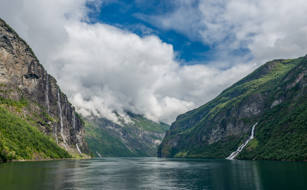 The two most notable waterfalls in the Geirangerfjord are the Seven Sisters and the Suitor (also called The Friar). Both falls face one another across the fjord, and the Suitor is said to be trying to woo the sisters.