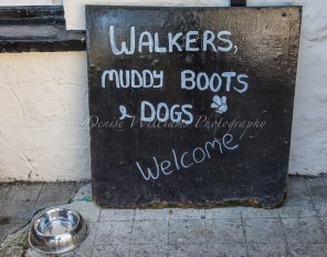 Welcoming sign outside the pub at Cadgwith, Cornwall