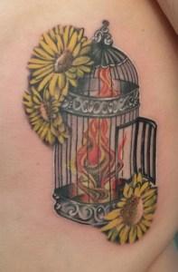 Tatuaggio fuoco e girasole