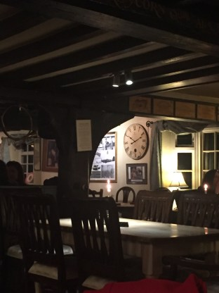 Clock and candles at the dining room of the John Barleycorn pub in Duxford