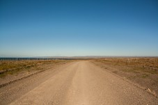 flat-gravel-road-with-magellan-straits-in-distance