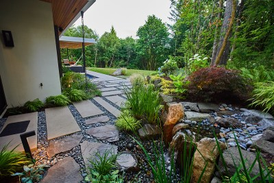 portland home with paver path and water feature