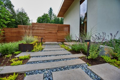 residential landscaping portland home fence and paver path