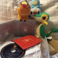 Unboxing Hanako Oku's 10th Anniversary Special Concert 2015 Blu-Ray set with Snivy, Tepig and Oshawatt.