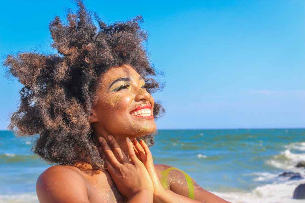 close up photo of woman with afro hair