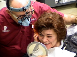 Patient feels elated when she sees her new teeth