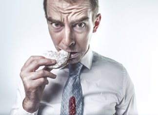 Man eating sugary foods that may cause a cavity.