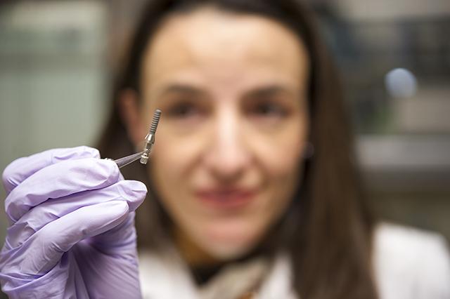 Dr. Pilar Valderrama holds an implant abutment.