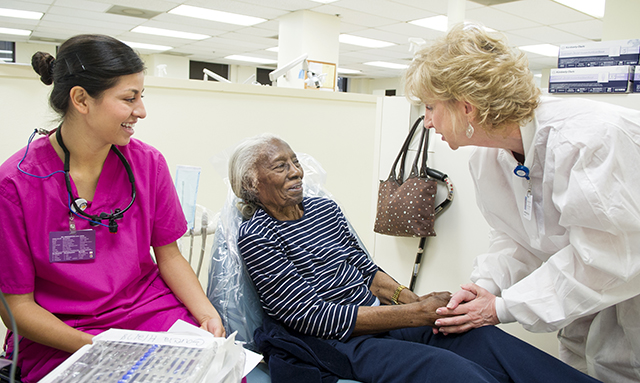 Cherri Kading, assistant professor and clinic coordinator, greets longtime patient Lizzie Mae Gray.