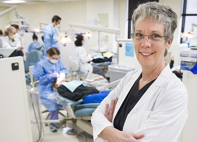 Laura Gene Utt, clinical assisttant professor in dental hygiene, in the college's third floor general dentistry clinic