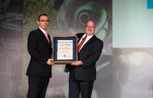 Dr. David Witherspoon, left, receives the President's Award from AAE president Dr. Robert Roda, '93, endodontics.