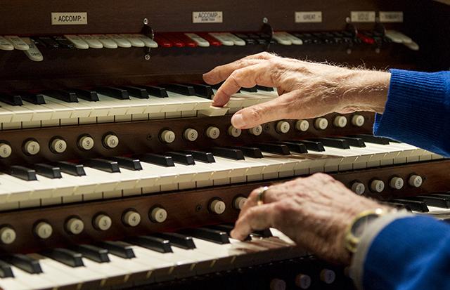Dr. Bill Hanson, '61, plays a theater organ in his Dallas home.