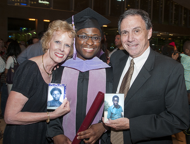 With foster parents Sandy and Deetz Shepherd, holding mementos of Kachepa's birth parents