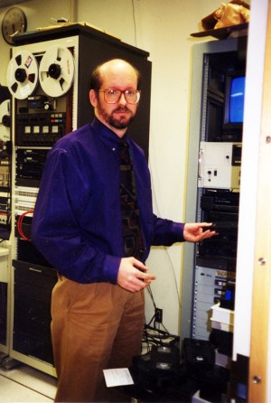 Frederick, with an analog reel-to-reel tape recorder