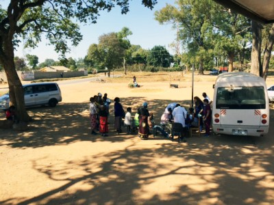 People line up outside the mobile dental unit to receive dental care.